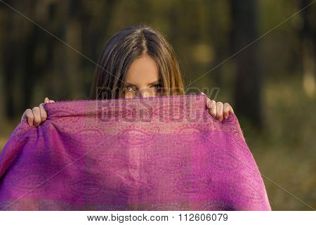 Behind Purple Scarf.