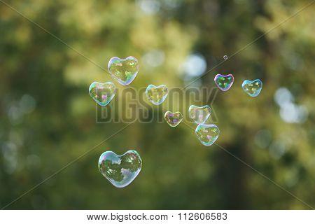 Soap bubbles in heart shape outdoor