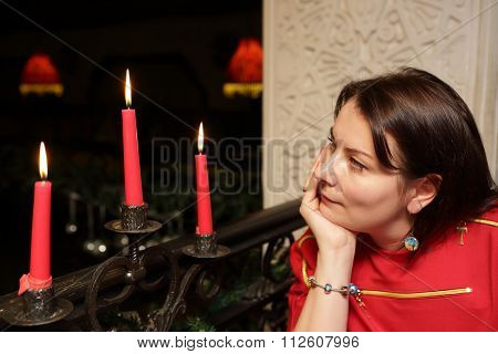 Woman Looking At Candles