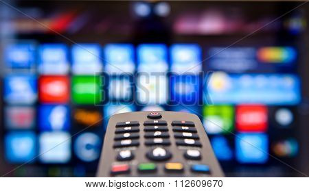 TV remote on a background of the smart TV.