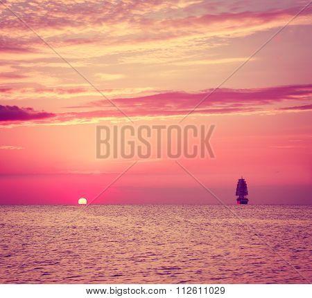 Sailing Ship in Sea at Sunset