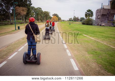 Group of people traveling on Segway in the park