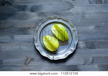 Plate Of Carambola Fruit On Wooden Background
