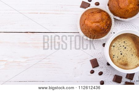 Coffee cup with a muffin .