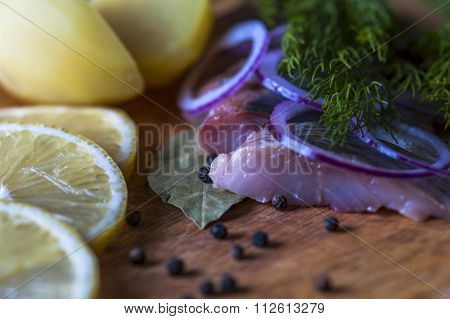 Fillets of herring, potatoes and lemon slices