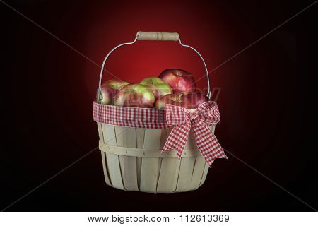 Imperfect Appels Basket Isolated On Black And Red