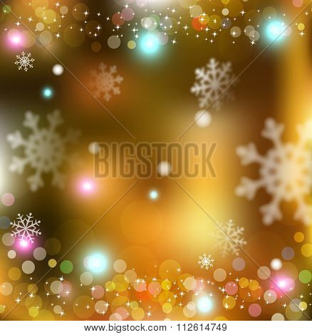 holiday gold  background with snowflakes blurred in the background