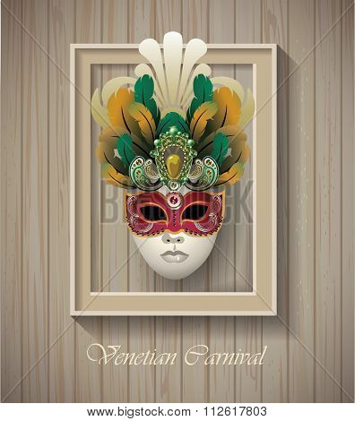 Venetian carnival mask with colorful feathers in border