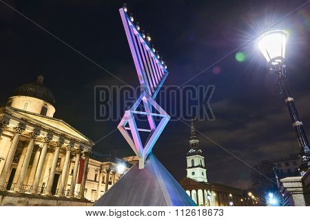 LONDON, UK - DECEMBER 13: Night shot of Menorah in Trafalgar Square with National Gallery and Saint Martin in the Fields church in the background. December 13, 2015 in London.