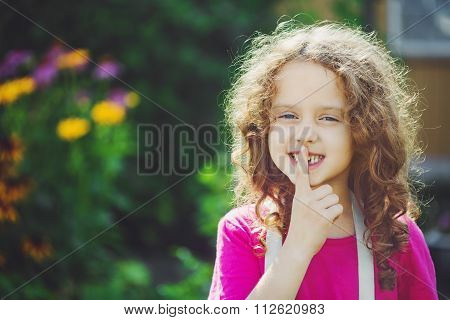 Little Girl Putting Finger Up To Lips And Ask Silence. Toning Photo.