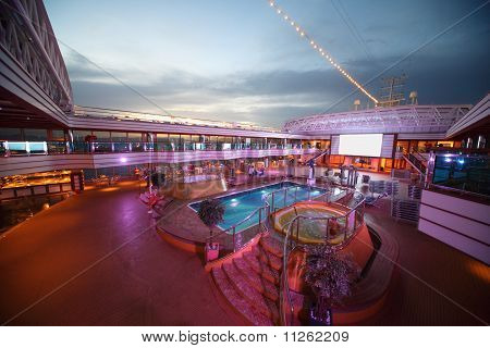 Overview of the deck of Costa Deliziosa with screen pool and baths - the newest Costa cruise ship