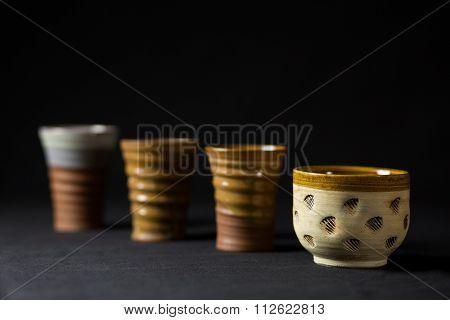 Ceramic cups in series