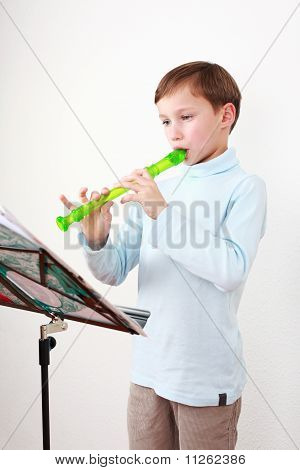 Little Boy Playing Flute
