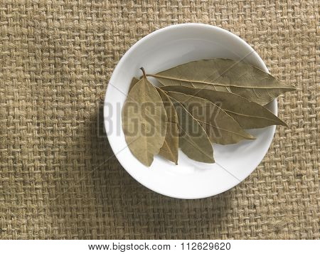 top view of the bay leaves on the burlap