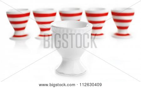 Red and White stripe egg cups, isolated on white