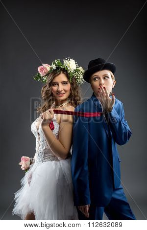 Same-sex marriage. Shot of elegant bride and groom