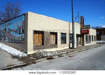 Abandoned Hardware Store with Patriotic Mural