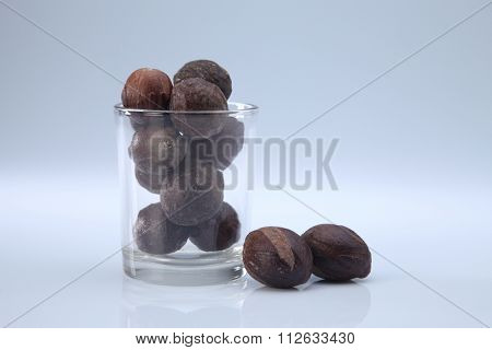 nutmeg seeds in a glass container