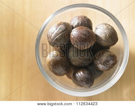top view of nutmeg on the wooden background