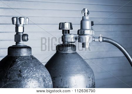 two blue oxygen cylinders close up