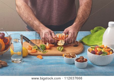 Man Cooking At Home Preparing Fruit Salad