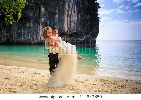 Groom Blonde Bride In Fluffy Dress Swing Barefoot On Beach
