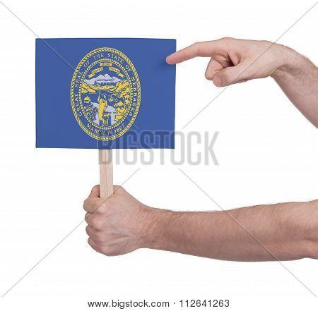 Hand Holding Small Card - Flag Of Nebraska