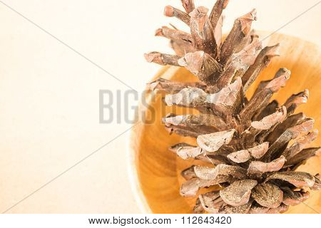 Dry Pine Cone On Wooden Table