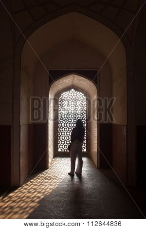 Filigree Window And Archway In Humayuns Tomb With Sun Casting Shaddow With Young Woman