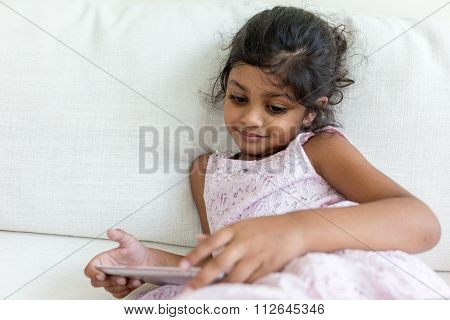 Indian little girl use of the tablet pc