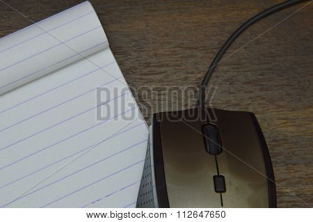 mouse and notebook on desk