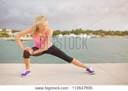 Runner stretching outdoors in early morning