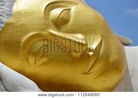reclining Buddha face under construction
