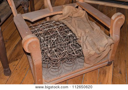 Broken Old Upholstered Chair With Springs.