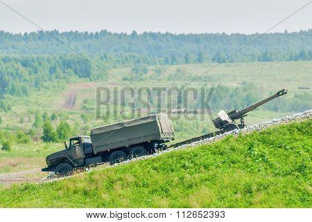 army truck transports a gun
