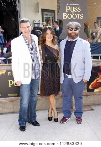 WESTWOOD, CALIFORNIA - October 23, 2011. Antonio Banderas, Salma Hayek and Zach Galifianakis at the Los Angeles premiere of