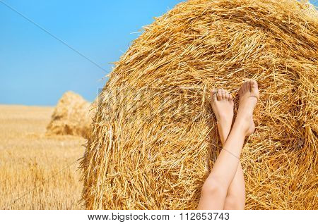 Feet on the background of hay.