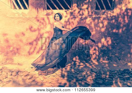 Asia Elegant Woman In Fluttering Black Long Dress