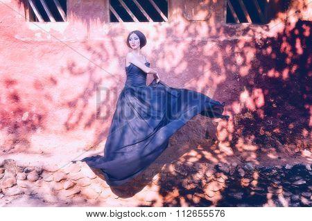 Asia Elegant Woman In Fluttering Black Long Dress