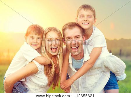 629939f1d0e Happy Young Family with two children walking on wheat summer field. Healthy  mother