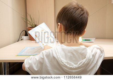 Boy Reading The Book And Consider New Knowledges