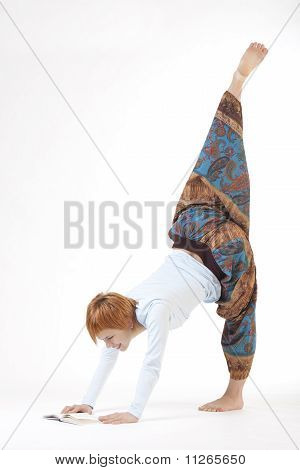 Girl yoga and reading a book