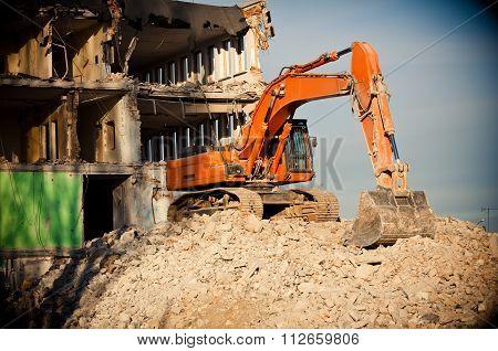 Orange Big Digger Destroys Building