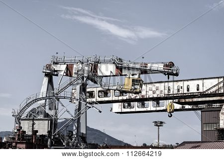 Big Crane In The Harbour Of Genova