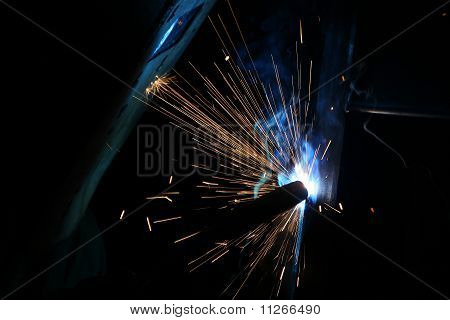 A Welder Working With Sparks Flying Around