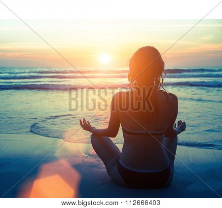 Meditation, serenity and yoga practicing at amazing sunset.