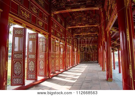 Red Shutters And Doors In The Citadel Of Hue, Vietnam