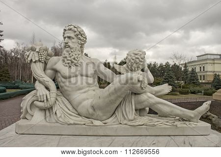 Sculpture Of The God Zeus And Cupid