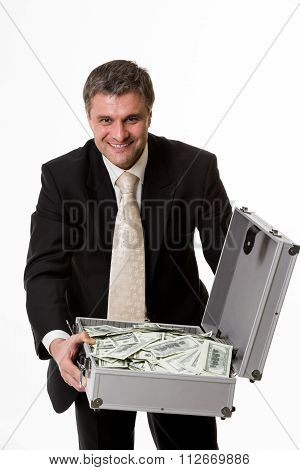 Man with suitcase full of money.