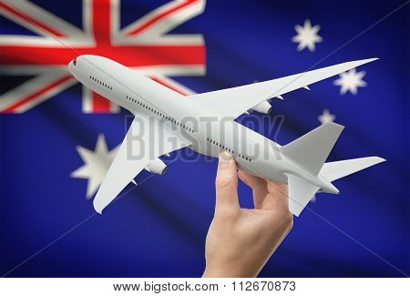 Airplane In Hand With Flag On Background - Australia